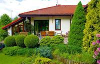 Dom parterowy z ogrodem zimowym